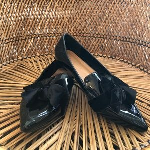 black pointed ballet flats with large bow